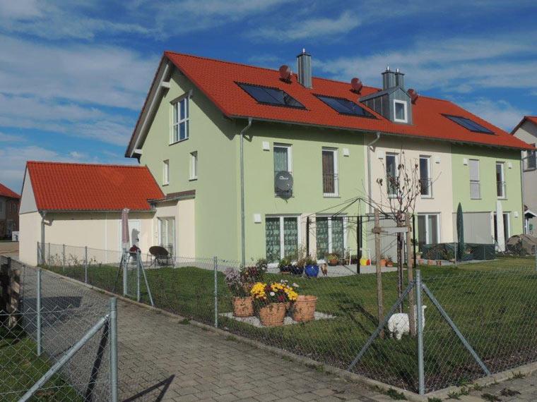 Reihenhaus mit Wohnungen kaufen bei München